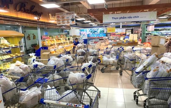 Hệ thống bán lẻ Saigon Co.op tiếp tục giảm giá nhu yếu phẩm và sản phẩm chống dịch ảnh 1
