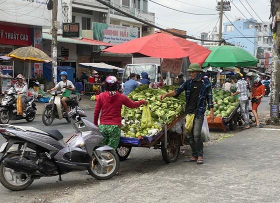 Những hình ảnh toàn dân phòng chống dịch tại Hà Nội và TPHCM ảnh 23