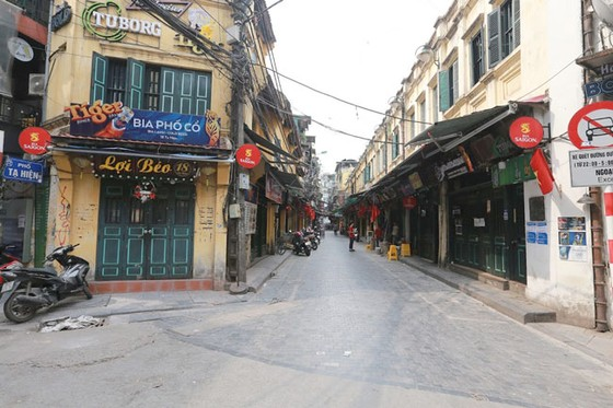 Những hình ảnh toàn dân phòng chống dịch tại Hà Nội và TPHCM ảnh 4