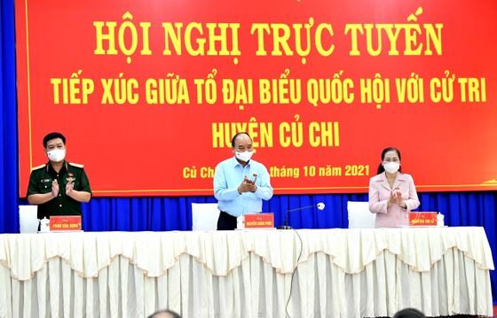 Chủ tịch nước Nguyễn Xuân Phúc gợi mở cách kiểm soát dịch và phát triển kinh tế cho TPHCM ảnh 4