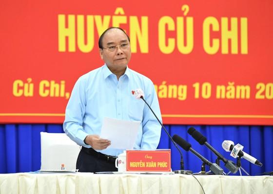 Chủ tịch nước Nguyễn Xuân Phúc gợi mở cách kiểm soát dịch và phát triển kinh tế cho TPHCM ảnh 1