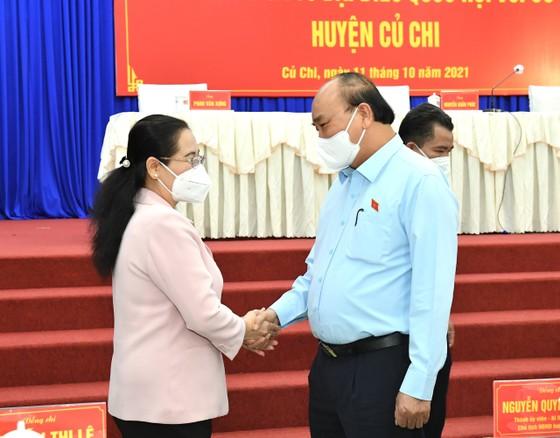 Chủ tịch nước Nguyễn Xuân Phúc gợi mở cách kiểm soát dịch và phát triển kinh tế cho TPHCM ảnh 13