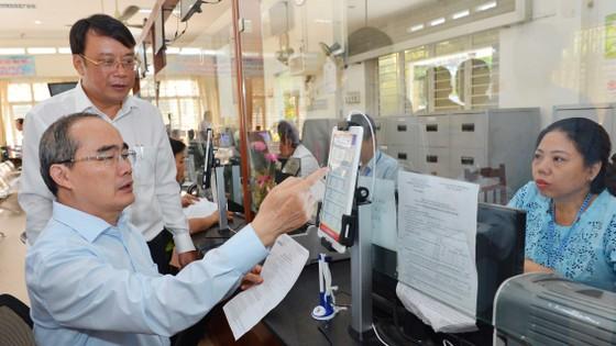 Bí thư Thành ủy TPHCM Nguyễn Thiện Nhân: Phải công khai sự hài lòng của người dân về cải cách hành chính ảnh 2