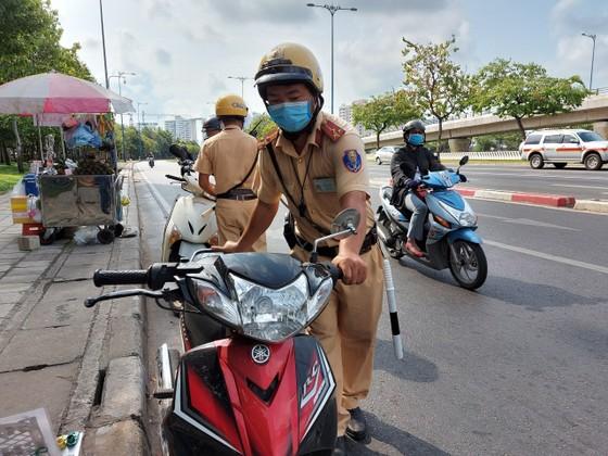 Xử lý 7.596 trường hợp vi phạm sau 1 tuần ra quân kiểm soát giao thông ở TPHCM ảnh 1