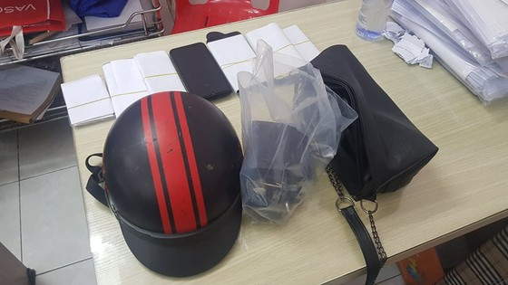 Một công an cùng bảo vệ dân phố phường bị tấn công ở quận Phú Nhuận ảnh 1