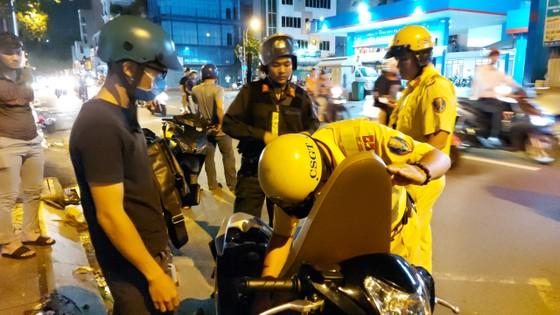 Giải tán kịp thời 370 xe máy tụ tập đua xe gây rối trật tự ở TPHCM ảnh 1