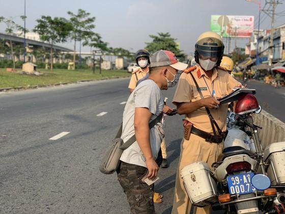 TPHCM tăng cường đảm bảo trật tự an toàn giao thông dịp Tết Nguyên đán 2021 ảnh 9