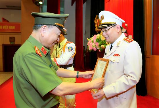 Người phát ngôn Bộ Công an được thăng hàm Trung tướng ảnh 1