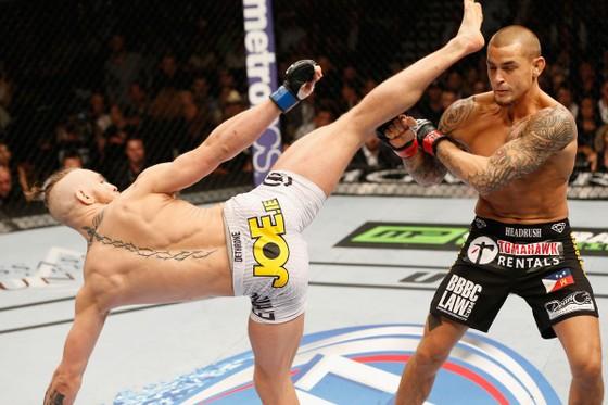 McGregor tung một cú đá vào mặt Poirier ở sự kiện UFC 178 hồi năm 2014