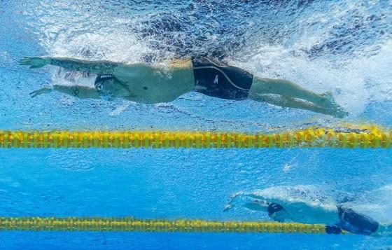 Giải bơi lội VĐTG: Dressel phá KLTG 10 năm tuổi của Phelps,VĐV 17 tuổi cũng phá KLTG 200m ngửa nữ ảnh 1