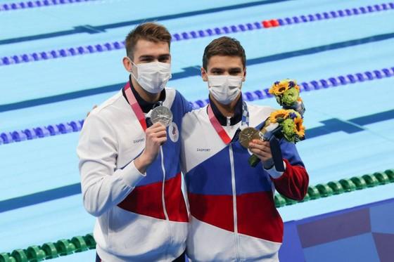 Kình ngư Evgeny Rylov giành HCV lịch sử cự ly 100m ngửa nam vốn thuộc 'thuỷ vực' của người Mỹ ảnh 5