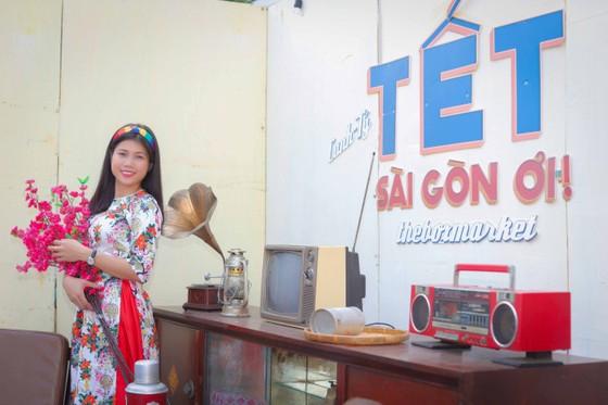 Người đẹp điền kinh Lê Thị Mộng Tuyền thướt tha trong tà áo dài truyền thống du xuân ảnh 10