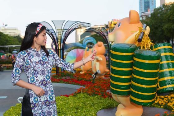 Người đẹp điền kinh Lê Thị Mộng Tuyền thướt tha trong tà áo dài truyền thống du xuân ảnh 13