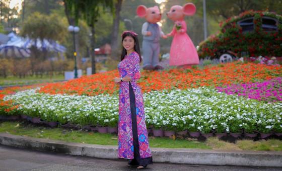 Người đẹp điền kinh Lê Thị Mộng Tuyền thướt tha trong tà áo dài truyền thống du xuân ảnh 12
