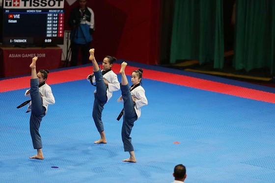 Taekwondo: Đồng đội nam vào bán kết, Châu Tuyết Vân thua VĐV chủ nhà ảnh 5