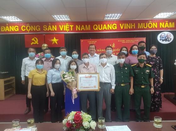 Cấp bằng Tổ quốc ghi công cho liệt sĩ 'hiệp sĩ' Nguyễn Hoàng Nam ảnh 7