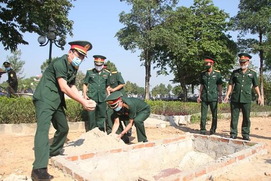 Quảng Trị: Tiếp nhận và an táng hài cốt liệt sĩ là quân tình nguyện, chuyên gia Việt Nam hy sinh tại Lào  ảnh 9
