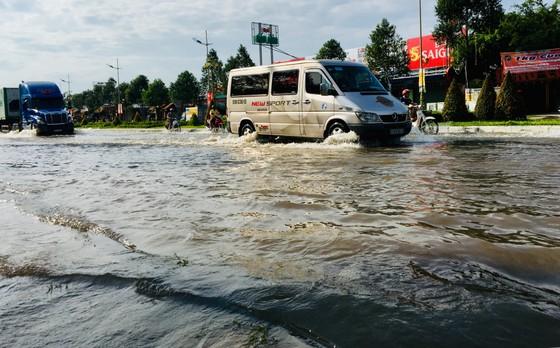 Cảnh báo đỉnh triều cường mới sẽ gây ngập lụt ở vùng trũng thấp, đô thị ven sông ĐBSCL ảnh 1