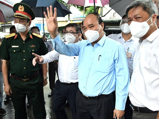 Chủ tịch nước Nguyễn Xuân Phúc đồng ý chủ trương giãn cách tại TPHCM thêm một thời gian nữa ảnh 5