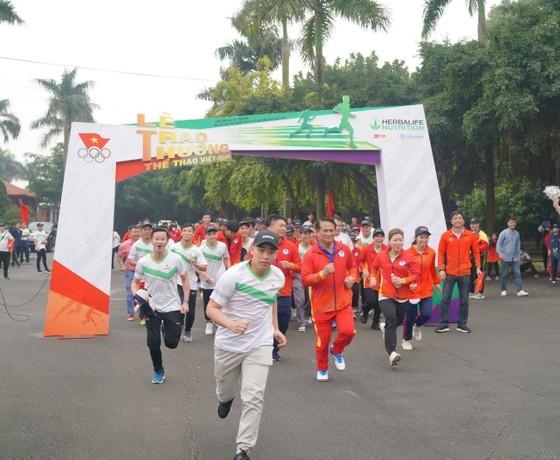 Herbalife Việt Nam đồng hành cùng Tổng Cục TDTT vinh danh VĐV, HLV tiêu biểu 2020 và tổ chức Ngày chạy Olympic vì sức khỏe toàn dân ảnh 6
