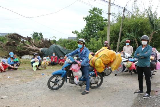 Long An đề nghị các tỉnh ĐBSCL phối hợp tổ chức đón người dân có nhu cầu trở về quê ảnh 1