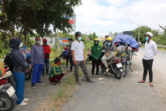 Long An đề nghị các tỉnh ĐBSCL phối hợp tổ chức đón người dân có nhu cầu trở về quê ảnh 3