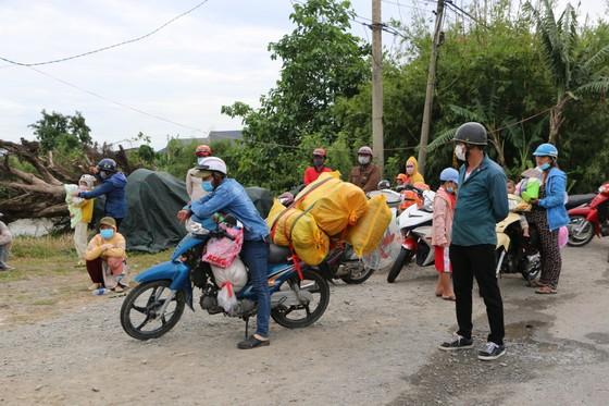 Long An đề nghị các tỉnh ĐBSCL phối hợp tổ chức đón người dân có nhu cầu trở về quê ảnh 4
