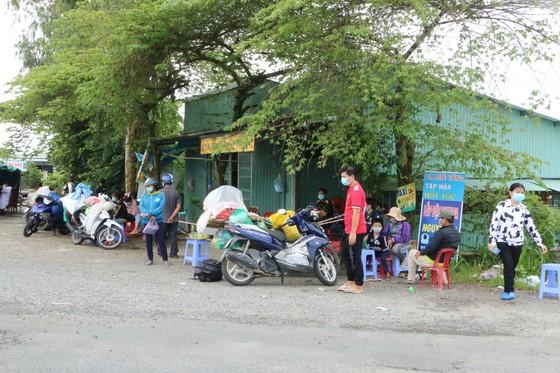 Long An đề nghị các tỉnh ĐBSCL phối hợp tổ chức đón người dân có nhu cầu trở về quê ảnh 5