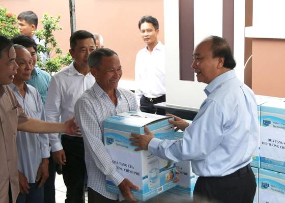 Thủ tướng Chính phủ Nguyễn Xuân Phúc khảo sát vùng chuyên canh sầu riêng tại Tiền Giang ảnh 3
