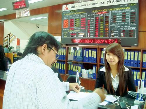 Lãi suất ngân hàng: Chưa cân đối vào, ra ảnh 1