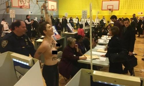 Phụ nữ ngực trần biểu tình nơi D.Trump bỏ phiếu ảnh 1