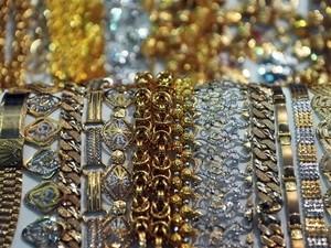 Giá vàng châu Á dao động quanh 1.710 USD ảnh 1