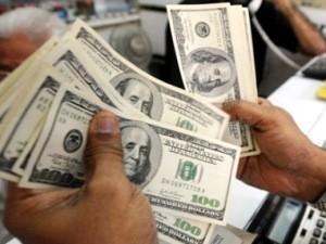 Hạn chế các tổ chức tín dụng găm giữ ngoại tệ ảnh 1