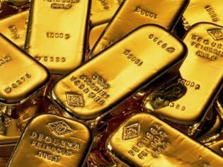 Vàng vững giá trên 1.390 USD/oz ảnh 1