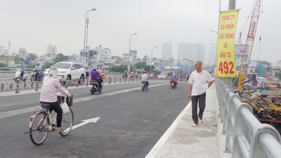 Thông xe nhánh mở rộng cầu Nguyễn Tri Phương ảnh 1
