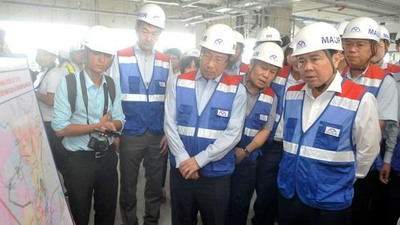 Phó Thủ tướng Phạm Bình Minh thị sát tiến độ thi công tuyến metro Bến Thành - Suối Tiên ảnh 4