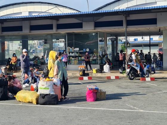 Vĩnh Long đón thêm 1.146 người dân từ TPHCM về quê  ảnh 1