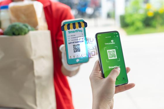 Vietcombank và SmartPay hợp tác thúc đẩy thanh toán bằng mã QR ảnh 1