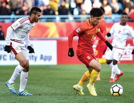 Đội Trung Quốc (áo đỏ) giành chiến thắng 3-0 trước Oman (AFC)