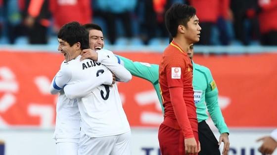 Uzbekistan có chiến thắng bất ngờ trước Trung Quốc. Ảnh: AFC