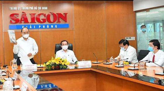 Chủ tịch nước Nguyễn Xuân Phúc: Báo SGGP đổi mới tư duy, quyết liệt hành động để xứng đáng vị thế của TPHCM ảnh 3