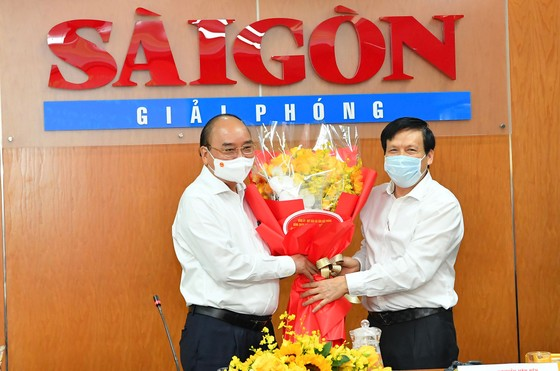 Chủ tịch nước Nguyễn Xuân Phúc: Báo SGGP đổi mới tư duy, quyết liệt hành động để xứng đáng vị thế của TPHCM ảnh 5