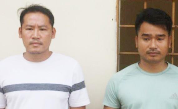 Hai đối tượng Nguyễn Đình Ngọc và Nguyễn Văn Việt tại cơ quan công an