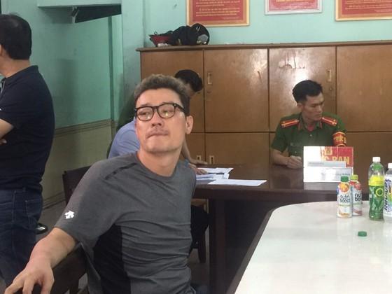 Lee Sam at police station (Photo: SGGP)