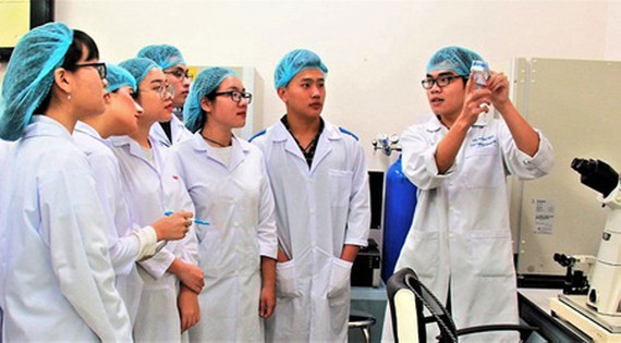 Researchers working in the International University under the Vietnam National University – HCMC. (Photo: SGGP)