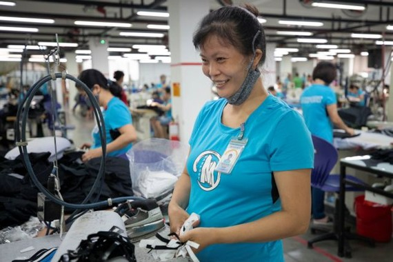 Tinh Nguyen, a seamstress for Maxport Limited Vietnam works on an assembly line in its Hanoi factory. Photo courtesy of IFC