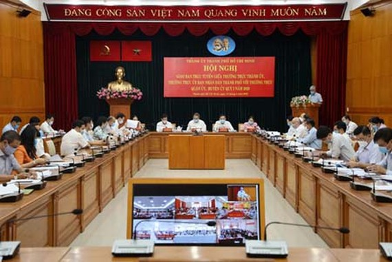 The teleconference regarding the fight of HCMC against Covid-19