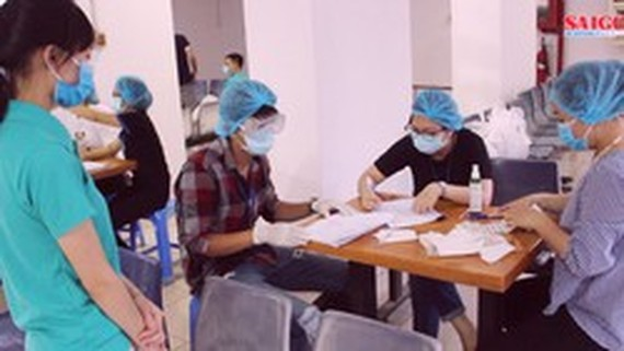 HCMC steps up workers testing