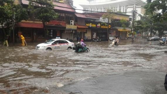 Hanoi streets flooded after a heavy rain (Source: VNA)