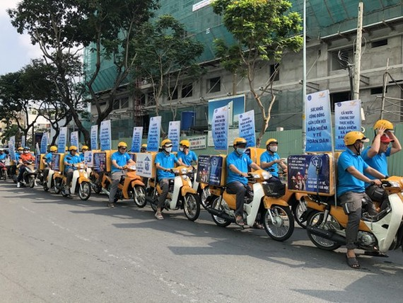 A motorbicycle parade is organized  in HCMC to encourage 60,000 residents to buy health insurance for individual and family (Photo: SGGP)